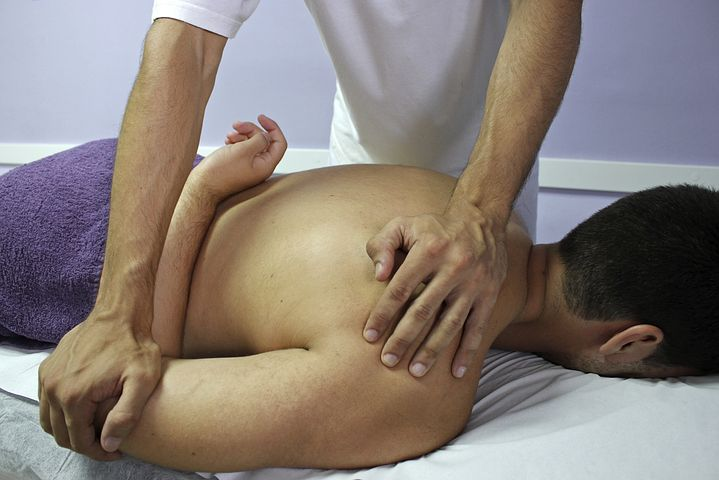 man getting a chiropractic treatment