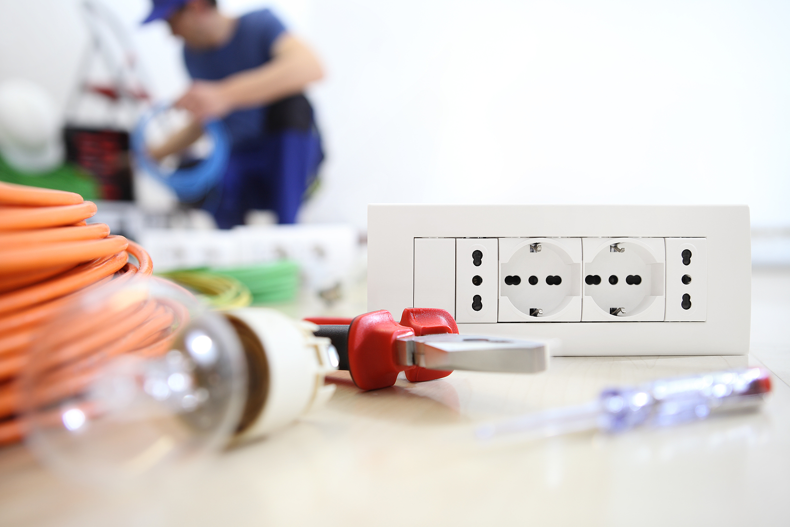 Electrician with electrical supplies in the floor