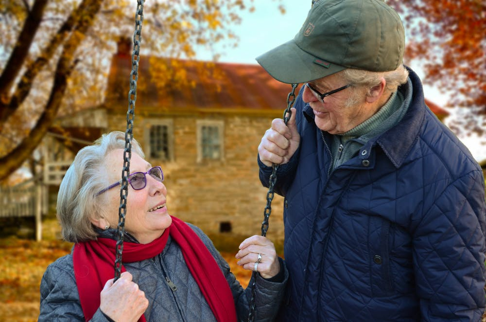 two senior citizen talking about aged care financial planning