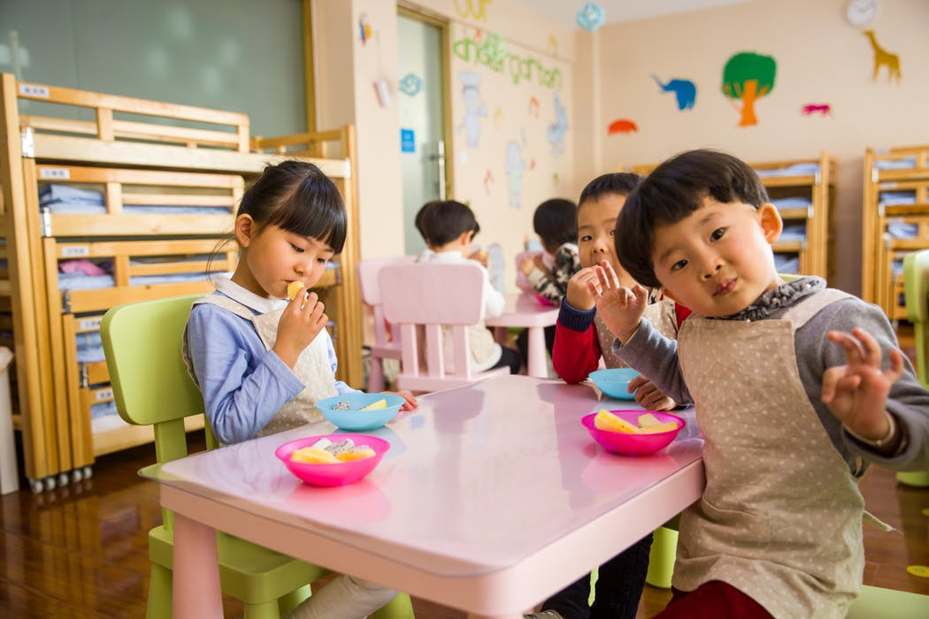 Kids inside a childcare in Punchbowl during their mealtime