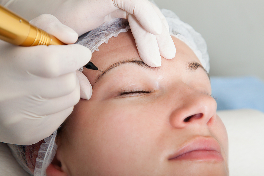 Woman getting an eyebrow tattoo in Sydney