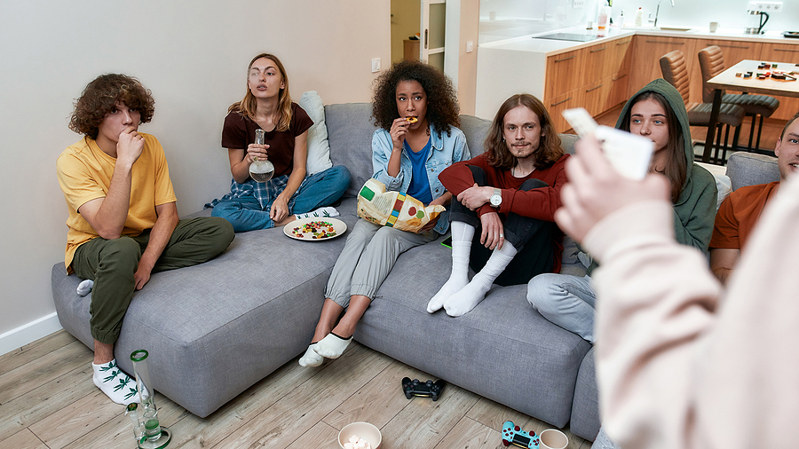 Group of young people smoking in modern glass bongs