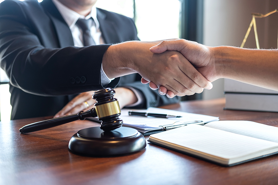 Domain Name Trademark Infringement lawyer meeting a client