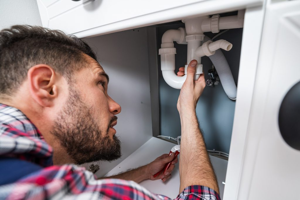 Canberra plumber fixing a sink pipe