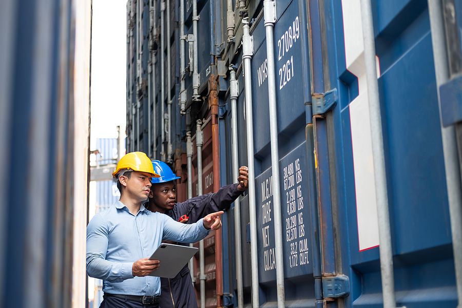 Freight forwarders inspecting the condition of the containers