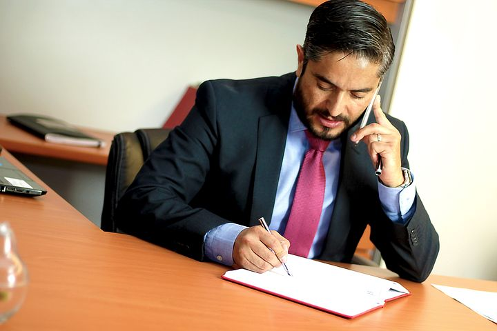 Best criminal lawyer in Melbourne talking to a client over the phone