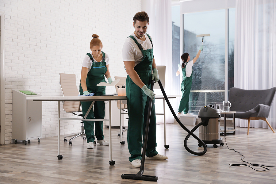 Team of professionals servicing building cleans
