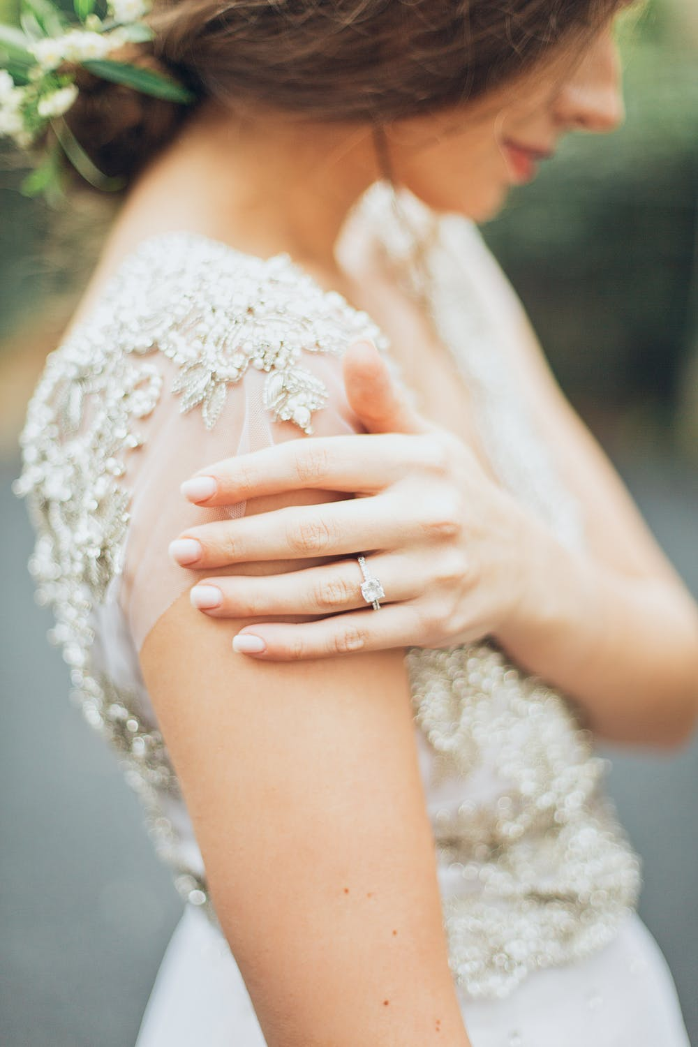 Woman showing off her wedding ring made in Melbourne